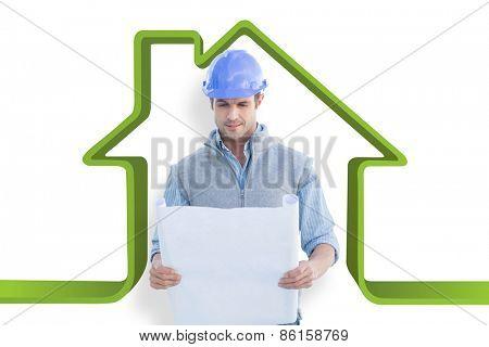 Architect reading blueprints against house outline