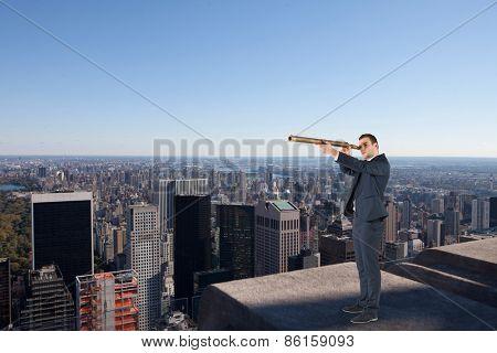 Businessman looking through telescope against city skyline