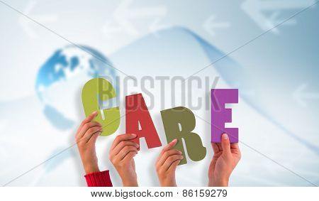 Hands holding up care against global business graphic in blue