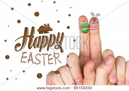 Fingers as easter bunny against happy easter graphic