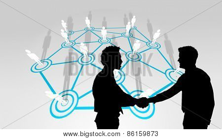Smiling young businessmen shaking hands in office against lines linking characters