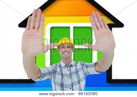 Architect forming hand frame against colorful house on white background