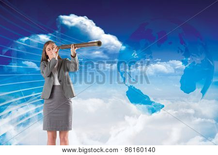 Businesswoman looking through a telescope against global business graphic in blue