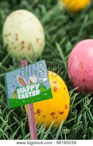 Easter egg hunt sign against colourful easter eggs