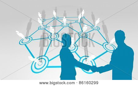 Smiling business people shaking hands while looking at the camera against lines linking characters
