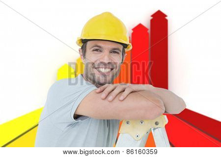 Happy technician leaning on step ladder against orange red and yellow arrows