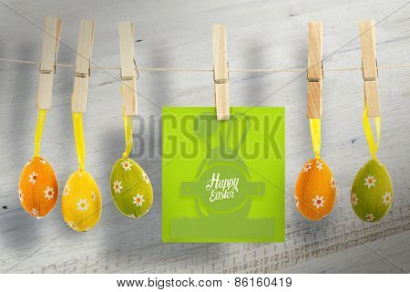 happy easter graphic against bleached wooden planks background