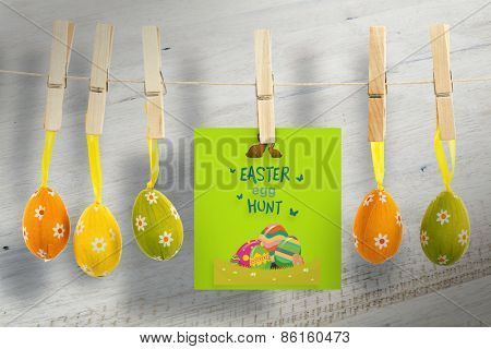 easter egg hunt graphic against bleached wooden planks background
