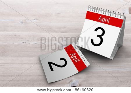 April calendar against bleached wooden planks background