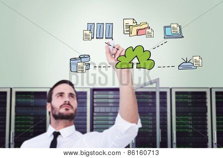 Focused businessman writing with marker against cloud computing doodle