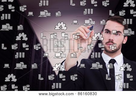 Thoughtful businessman writing with marker against cloud computing doodle