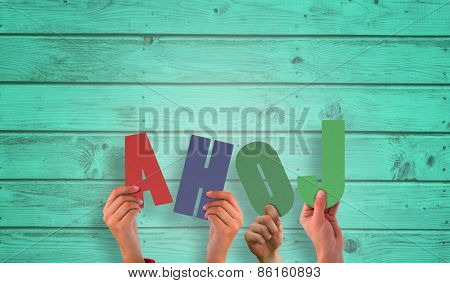 Hands holding up ahoj against digitally generated grey wooden planks