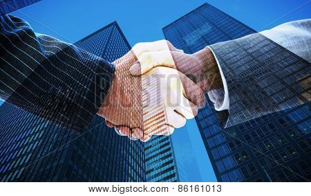 Business people shaking hands against skyscraper