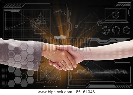 Handshake between two women against technology interface