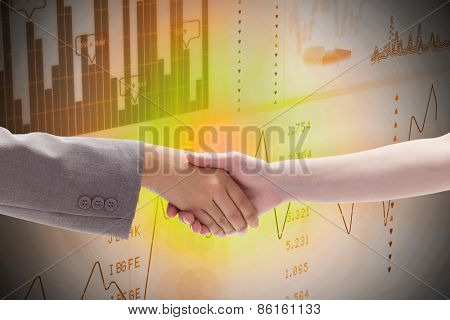 Handshake between two women against business interface