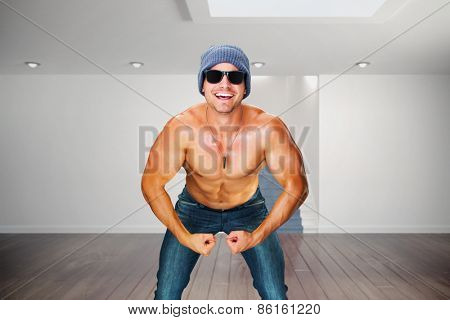Attractive bodybuilder against digitally generated room with stairs