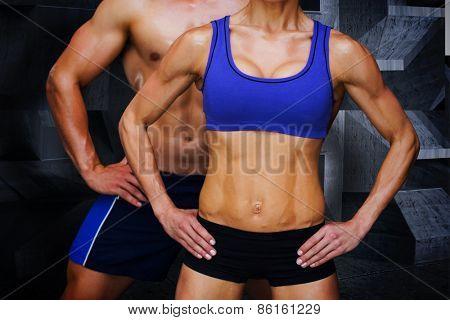Bodybuilding couple against dark room