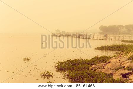 Vintage Landscape With Lake And Fog