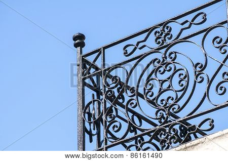 Wrought-iron black balcony corner