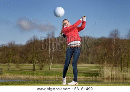 Woman Golfer Hitting The Golf Ball