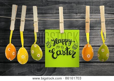 Happy Easter greeting against overhead of wooden planks