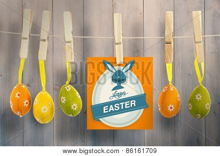 Happy Easter greeting against pale grey wooden planks
