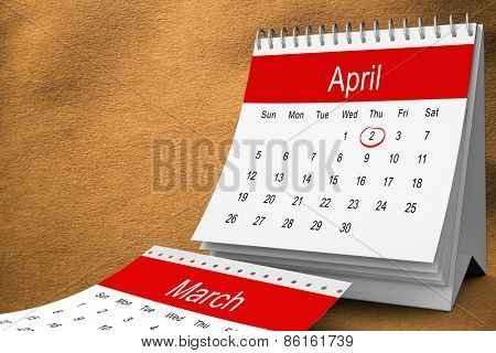 April calendar against beige background texture