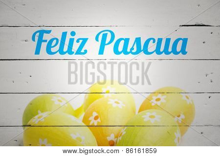 feliz pasqua against six easter eggs together