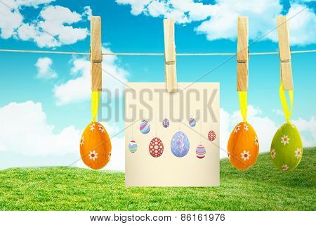 easter eggs against field and sky