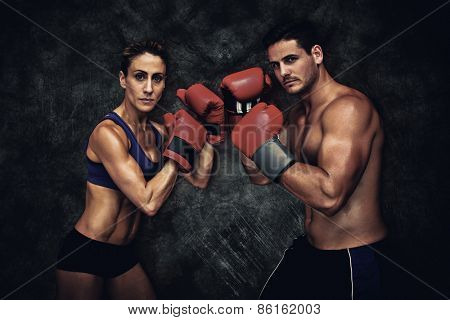 Boxing couple against dark background
