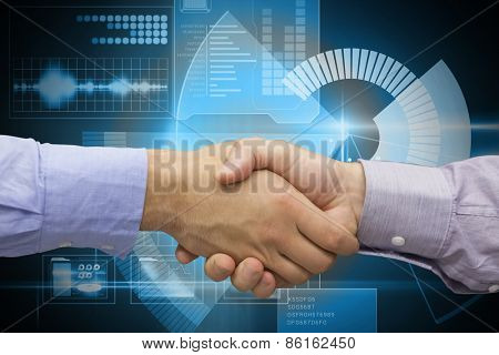 Hand shake in front of wires against blue technology interface with dial