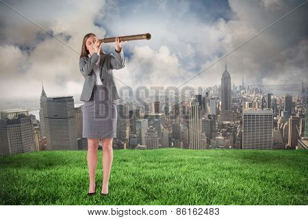 Businesswoman looking through a telescope against cloudy sky over city