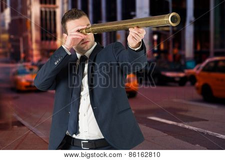 Businessman looking through telescope against blue bar chart graphic with light