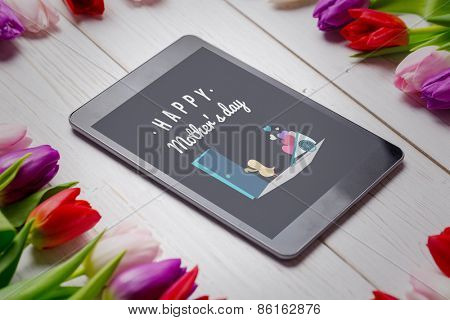 Chick with wheelbarrow of hearts against tulips on desk