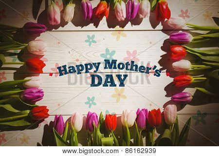 mothers day greeting against tulips on table