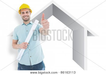 Male architect with blueprint gesturing thumbs up against house outline