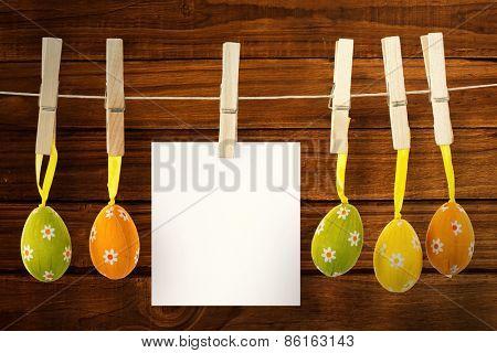 hanging easter eggs against overhead of wooden planks