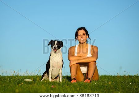 Woman And Dog Enjoying Tranquility Outdoor