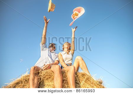 Couple On A Bale Of Hay