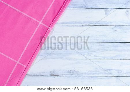 Pink tablecloth on white wood background