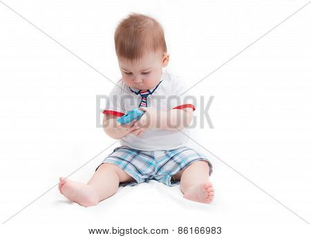 Little Baby Sitting And Holding Smartphone