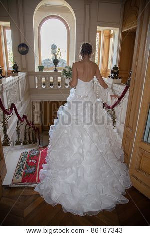 A Bride Descends A Staircase To See Her Groom