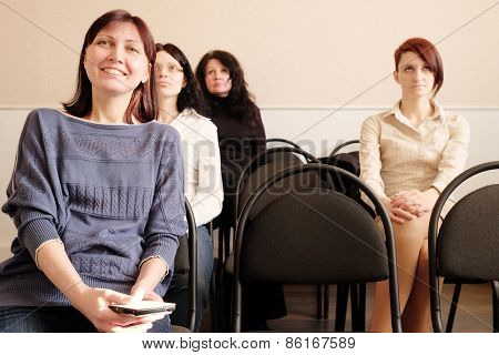 Group of womans sitting in education class