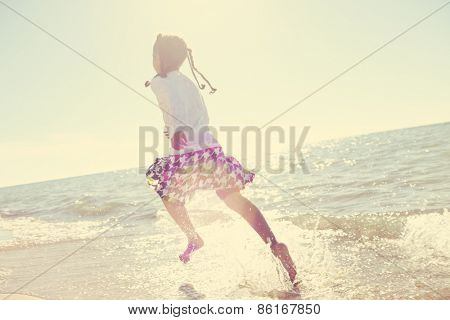 Girl running at the beach,  motion blur, Instagram effect.