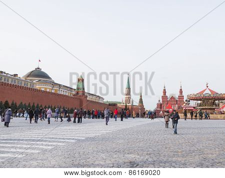 Many People And Tourists Walk On The Red Square In Moscow