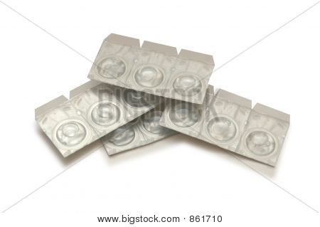 Contact Lenses In Containers Isolated On White