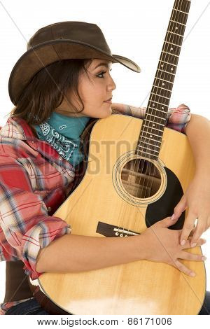 Woman Cowgirl With Guitar Arms Around Look To Side