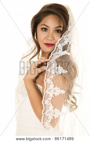 Woman In Wedding Dress With Veil On Looking