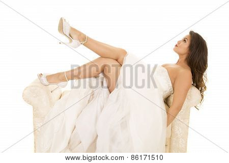 Woman Laying In Wedding Dress Legs Out Look Up