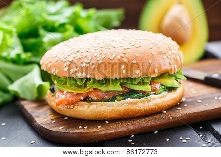 Burger with salmon and avocado